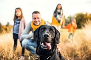 A family in a grass field with their dog looking happy